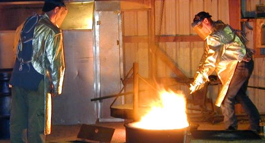 The author of his blog (left) and his brother (right) melt brass in preparation for pouring into molds.