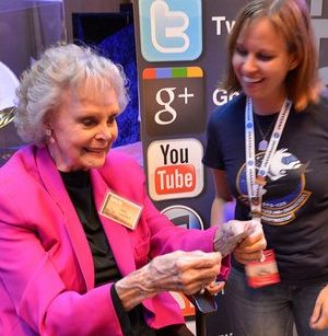 Susan Bell presents June Lockhart with MSL NASA Social Mission Patch. Photo by Dennis Hoffbuhr.