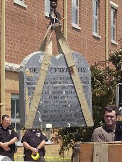 A Ten Commandments monument is removed from a school in West Union, Ohio, in June 2003.